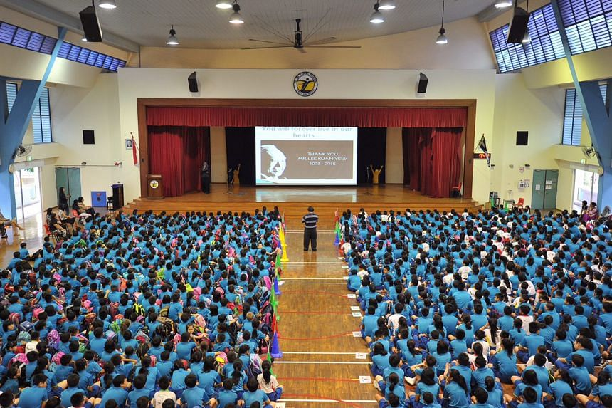 Pupils at Telok Kurau Primary watching a slideshow during a special assembly to honour Mr Lee Kuan Yew. ST PHOTO: LIM YAOHUI