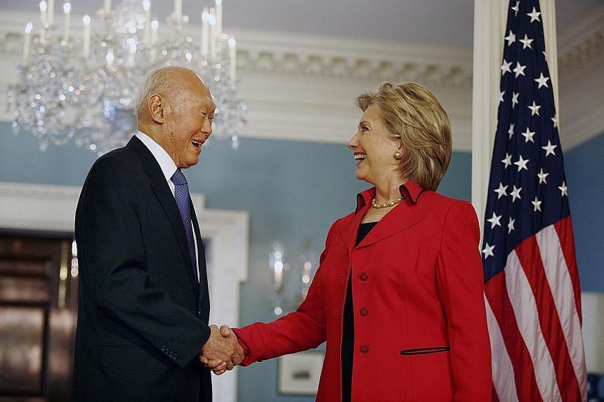 Mr Lee meeting Mr Hu Jintao (above) in Singapore on Nov 11, 2009, and Mrs Hillary Clinton (right) at the US State Department on Oct 26, 2009. Mr Lee was a strong advocate of having a balance of power to create a conducive environment for small countr