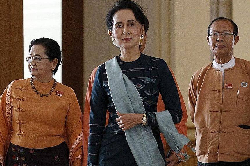 National League for Democracy party leader Ms Suu Kyi (centre) arriving at Parliament in Naypyitaw on March 15. She is tipped to take the Foreign Affairs, President's Office, Education and Energy ministries.