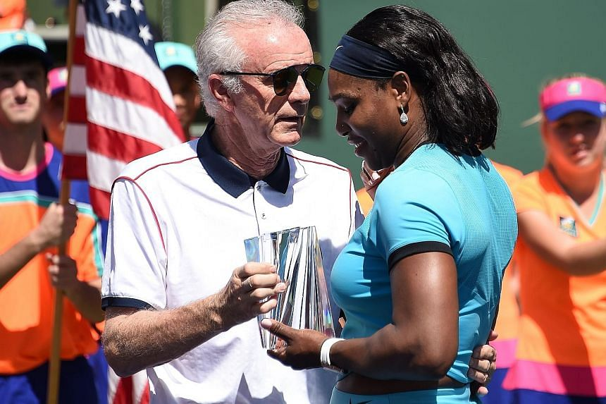 Raymond Moore presenting the runner-up trophy to Serena Williams after the women's final of the BNP Paribas Open at Indian Wells, where she lost to Victoria Azarenka 4-6, 4-6. Moore has since stepped down as chief executive and tournament director.