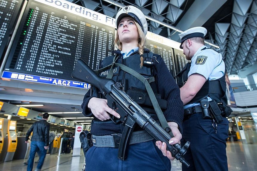 German police on patrol at the Frankfurt airport yesterday as Europe beefs up security at transport hubs and borders after the attacks.