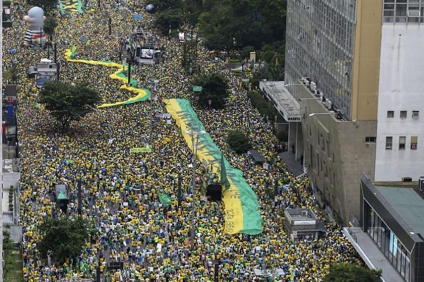 Brazilians rallying in Sao Paulo earlier this month to express support for investigations into a major corruption scandal at state oil company Petrobras.
