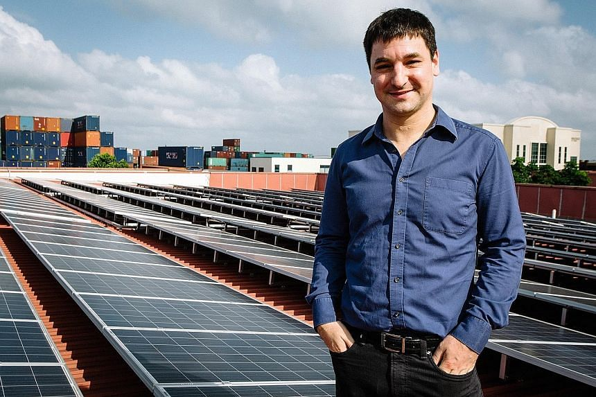 Dr Peloso on the rooftop of a JTC factory in Tuas South where Sun Electric's solar generators are situated. Seven consumers are getting electricity from this source.