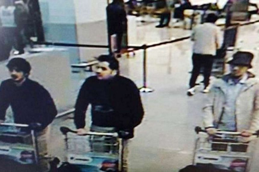 """This CCTV image from the Brussels Airport surveillance cameras shows what officials believe may be suspects in the Brussels airport attack on March 22, 2016. The Belgian state prosecutor said """"two of them seem to have committed suicide attacks. The t"""