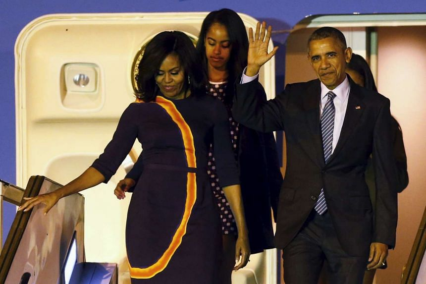 US President Barack Obama and First Lady Michelle Obama (left) arrive for their visit to Argentina with their daughters Malia (centre) and Sasha.