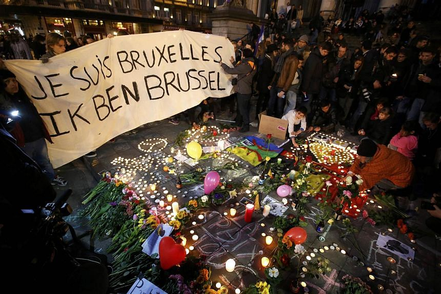 People display a solidarity banner following bomb attacks in Brussels, Belgium on March 22.