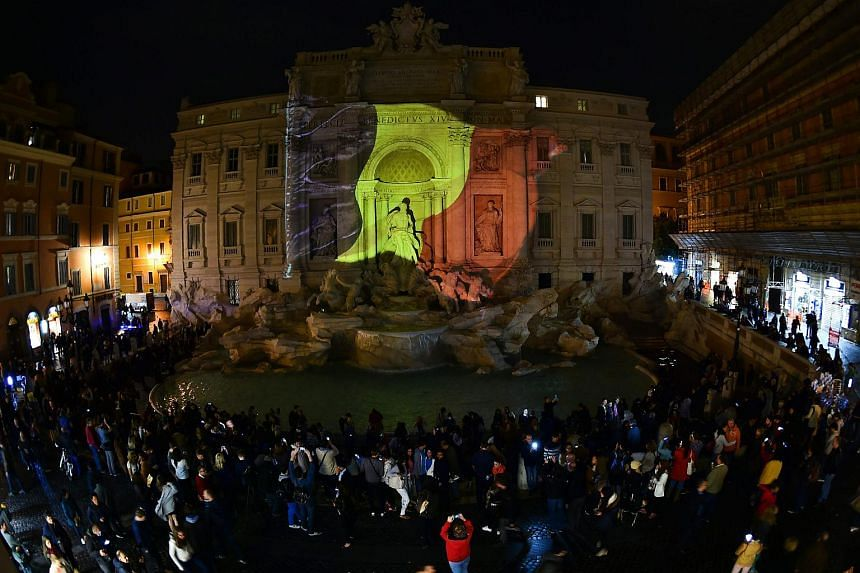 A Belgian flag is display on the Trevi Fountain in Rome on March 22, 2016 in tribute to the victims of the bomb attacks in Brussel.