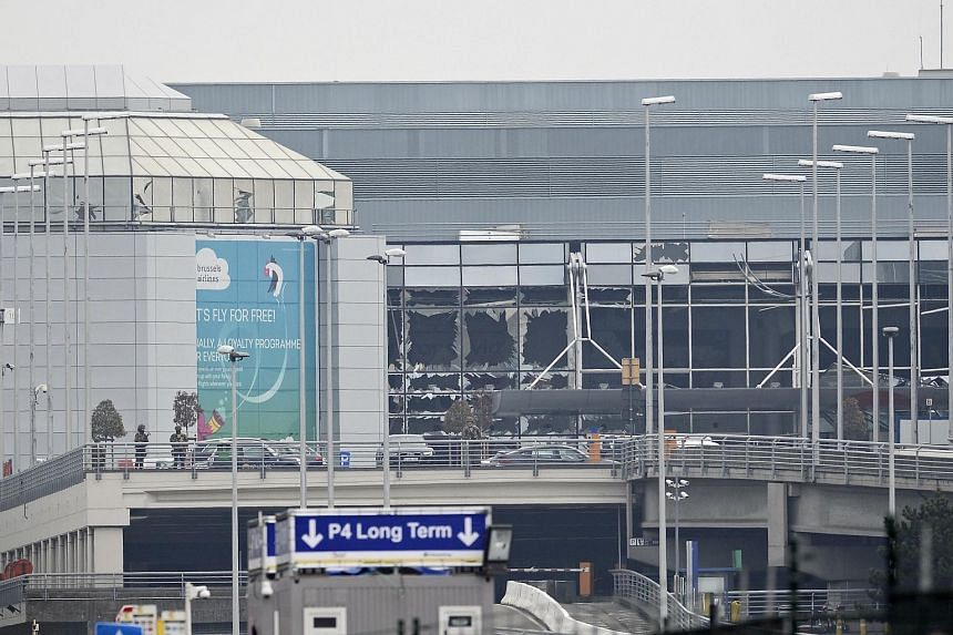 A picture shows damage to the facade of Brussels Airport, in Zaventem, on March 22, 2016.