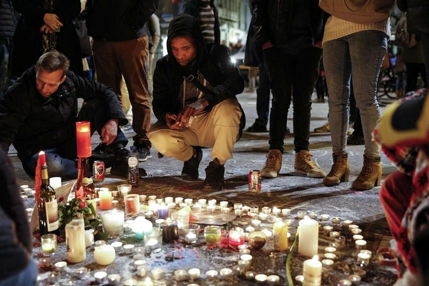 People keeping vigil at the Place de la Bourse to pay tribute to the victims of the attacks in Brussels on March 22.