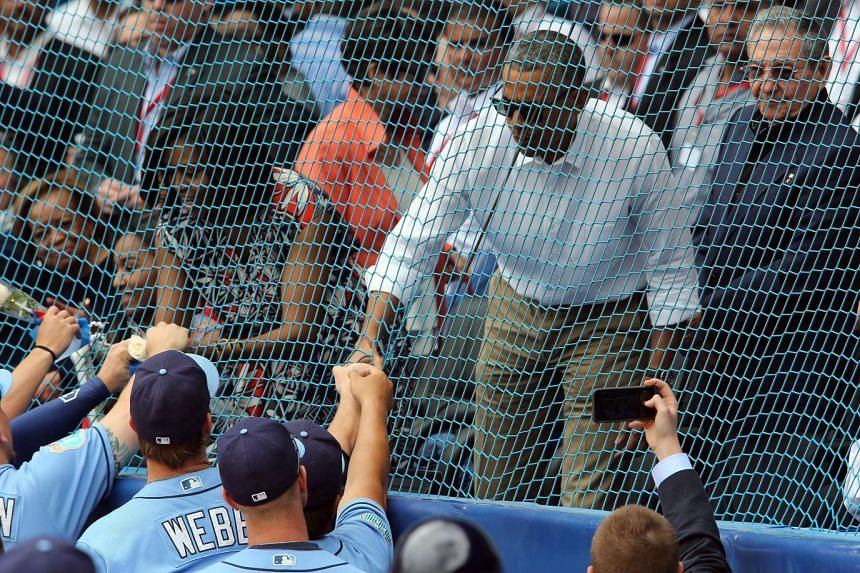 US President Barack Obama (centre) and Cuban President Raul Castro (right) attending a Major League Baseball exhibition game in Havana on March 22.