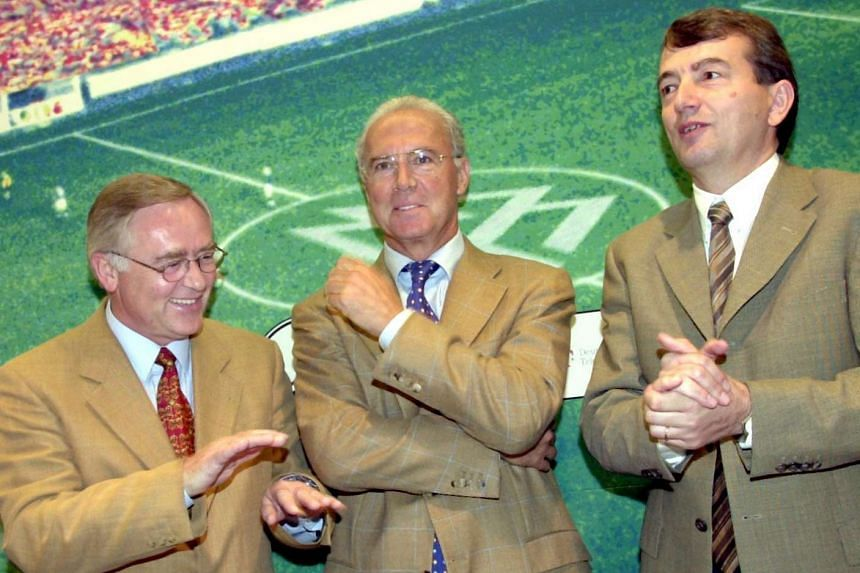 World Cup organising committee chief Franz Beckenbauer (centre), with German football federation's Horst R. Schmidt (left) and Wolfgang Niersbach (right) in a Sept 29, 2000, file photo.