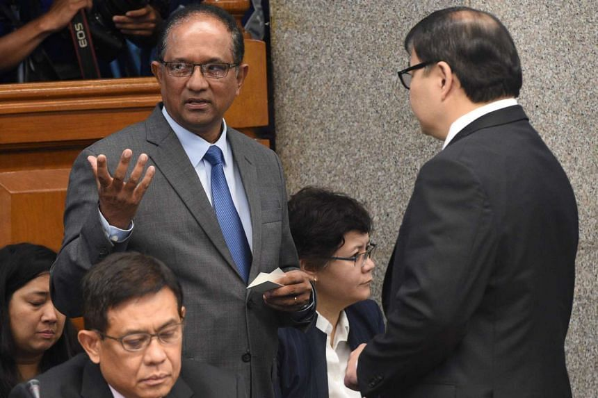 Bangladesh Ambassador to the Philippines John Gomes (standing left) talks to Rizal Commercial Banking Corp president Lorenzo Tan (standing right) at the Manila senate hearing.