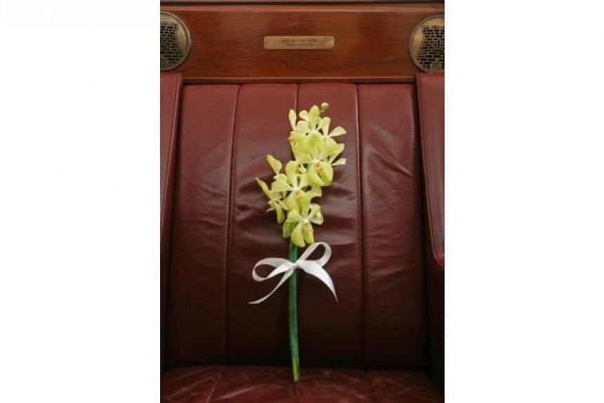A stalk of orchids was placed on the seat of the late Mr Lee Kuan Yew.