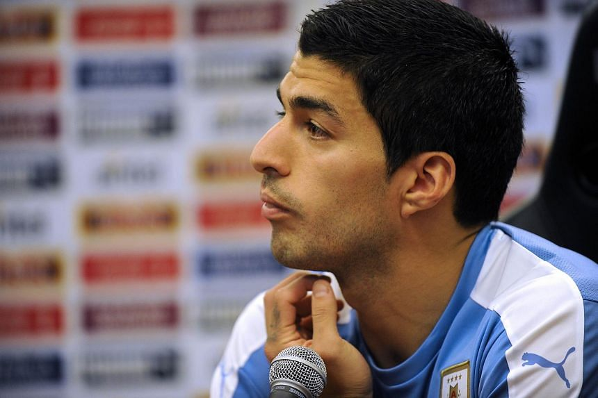 Uruguay player Luis Suarez gestures during a press conference in the Complejo Celeste in Montevideo.