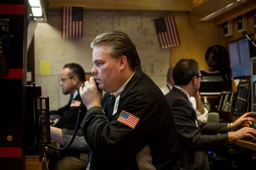 Traders working on the floor of the New York Stock Exchange on March 16.