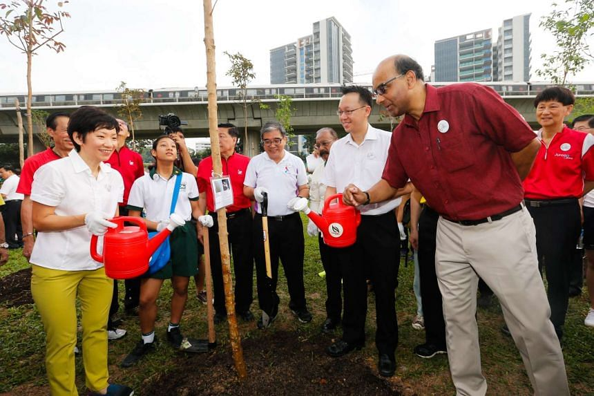 Minister for Culture, Community and Youth Grace Fu (left) and Deputy Prime Minister Tharman Shanmugaratnam at the tree-planting event at Jurong Lake Park.