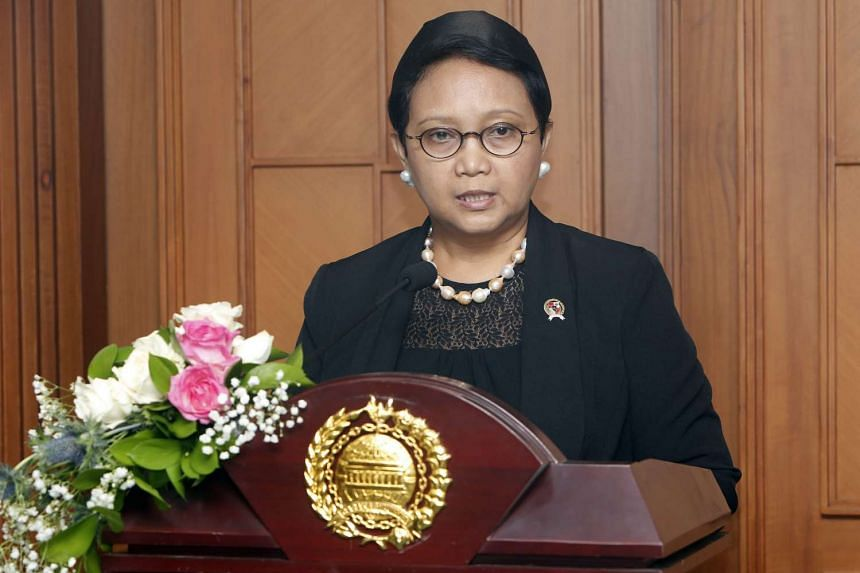 Indonesian Foreign Minister Retno Marsudi talks to journalists during a press conference in Jakarta.