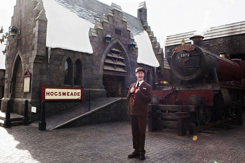 A wand shop and a Hogwarts Express train (above) at the attraction.