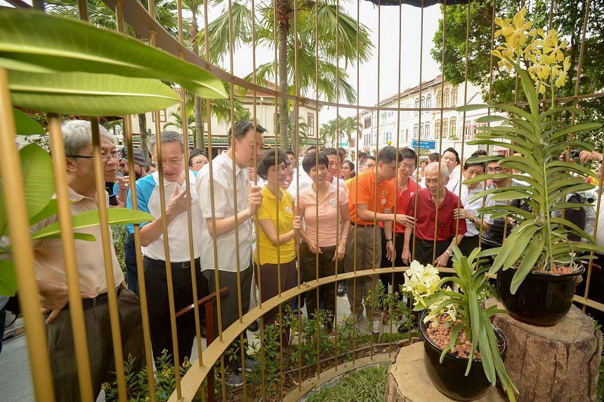 Admiring the Aranda Lee Kuan Yew and Vanda Kwa Geok Choo orchids at Tanjong Pagar Plaza's newly restored Orchid Pavilion at Saturday's remembrance event were (in front row, from left) former Tanjong Pagar GRC MP Koo Tsai Kee; Radin Mas MP Sam Tan; Tanjong
