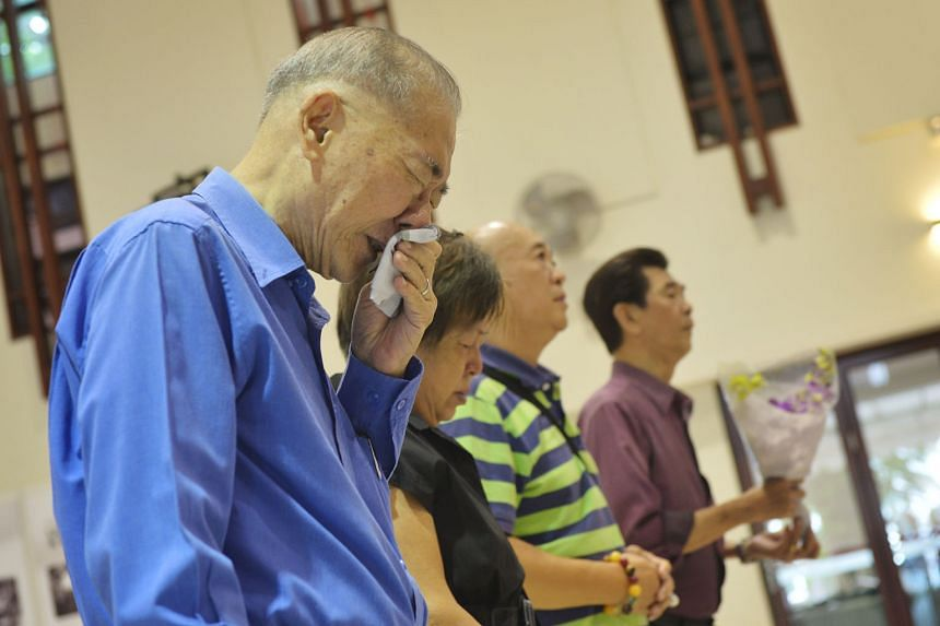 Retired calligrapher Seow Cheong Choon (in blue shirt) says time has helped him to overcome his grief. He was photographed last year with tears running down his face as he paid his respects to Mr Lee.