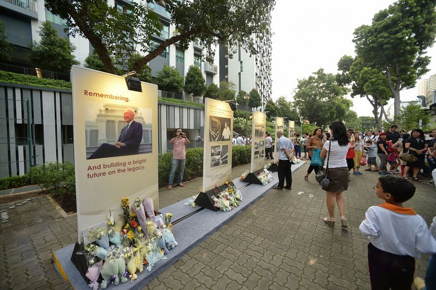 Members of the public paying tribute to Mr Lee at a Tanjong Pagar commemorative event, ahead of the first anniversary of his death today. Thousands of Singaporeans are setting time aside this week to remember Mr Lee's life and legacy as the leader of this
