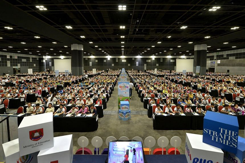Last year's record of 1,654 participants (above) has been broken this year, with more than 1,800 pupils signing up for the national spelling competition, which kicks off this Saturday at Suntec Singapore.