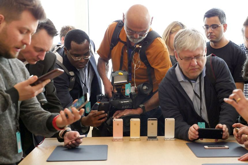 Members of the press taking photos and videos of the new 4-inch iPhone SE at Apple Campus Town Hall in Cupertino, US. The smartphone goes on sale in 12 markets, including Singapore, next week.