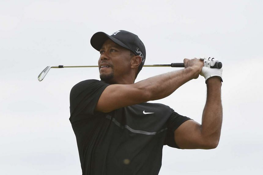 Tiger Woods hits his tee shot on the 2nd hole in the first round of the 2015 US Open golf tournament at Chambers Bay.