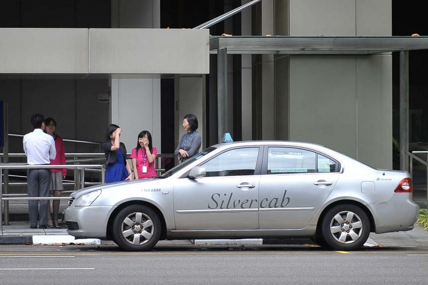 A Premier Silvercab taxi at a taxi stand in Shenton Way.