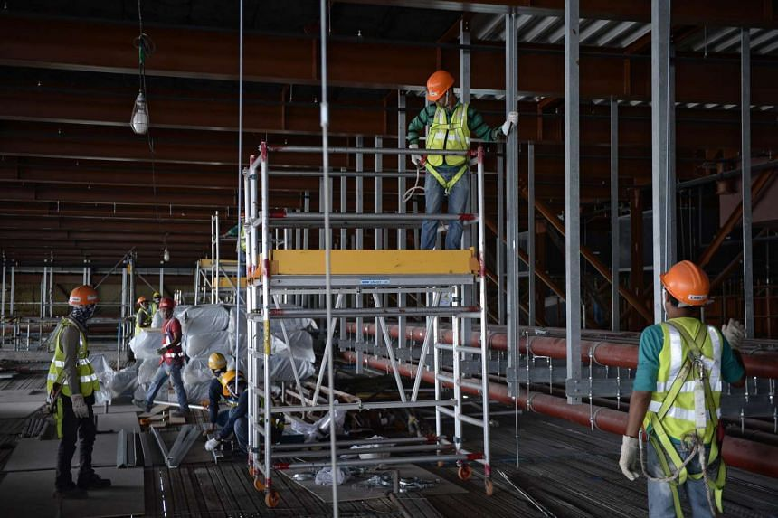 Construction workers pictured at a construction site at Changi Airport Terminal 4, Feb 10, 2016.