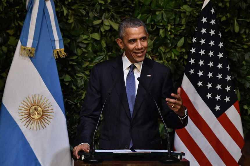 US President Barack Obama delivers a speech during a state dinner with Argentine President Mauricio Macri at the Kirchner Cultural Centre in Buenos Aires on March 23, 2016.
