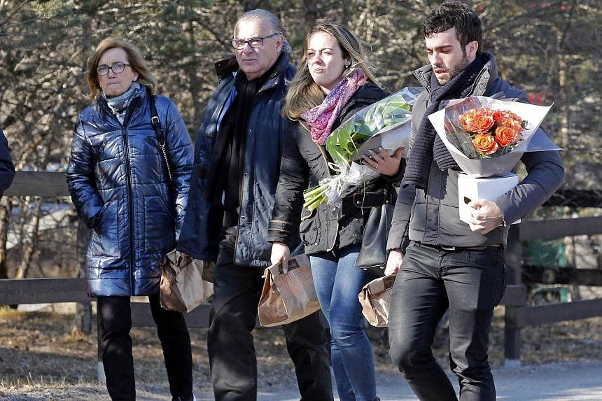 Members of victim's families arrive to attend a ceremony for the first anniversary of the Germanwings crash at the memorial site in Le Vernet, France.