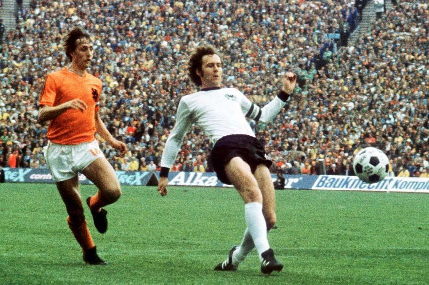 Johan Cruyff (left) in action against Franz Beckenbauer during the Fifa 1974 World Cup final match on July 7, 1974.