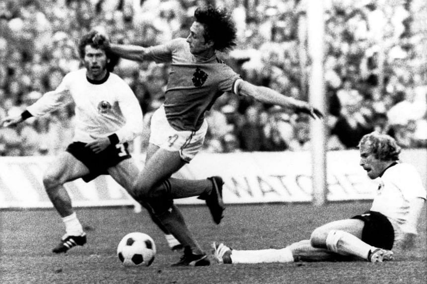 Johan Cruyff (centre) in action against Paul Breitner (left) and Berti Vogts during the Fifa 1974 World Cup final match on July 7, 1974.