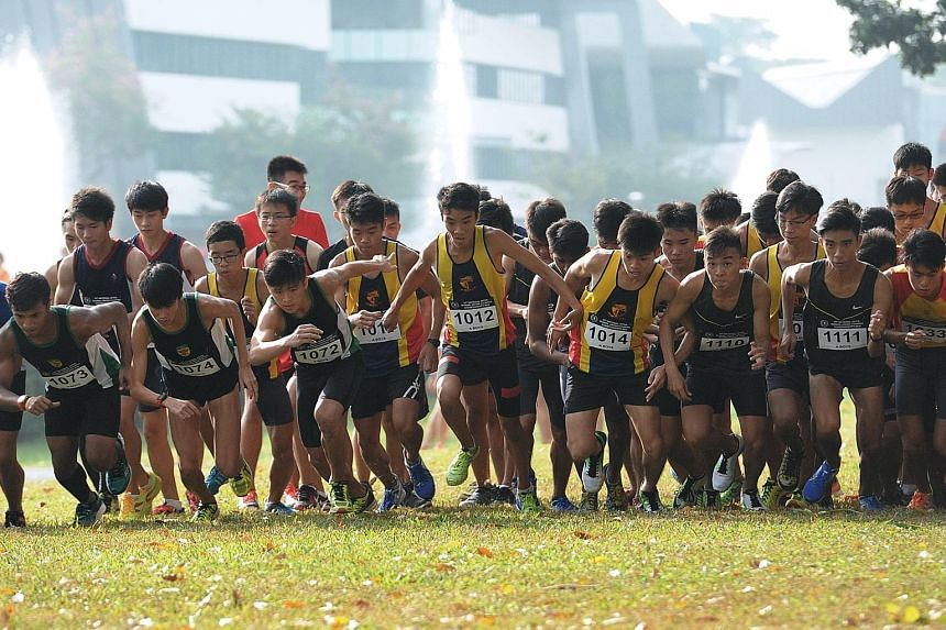 The flag-off for the A Division race, which Isaac Tan (1014) of ACS(I) won in 16min 15.07sec on the 4.6km course at Bedok Reservoir.