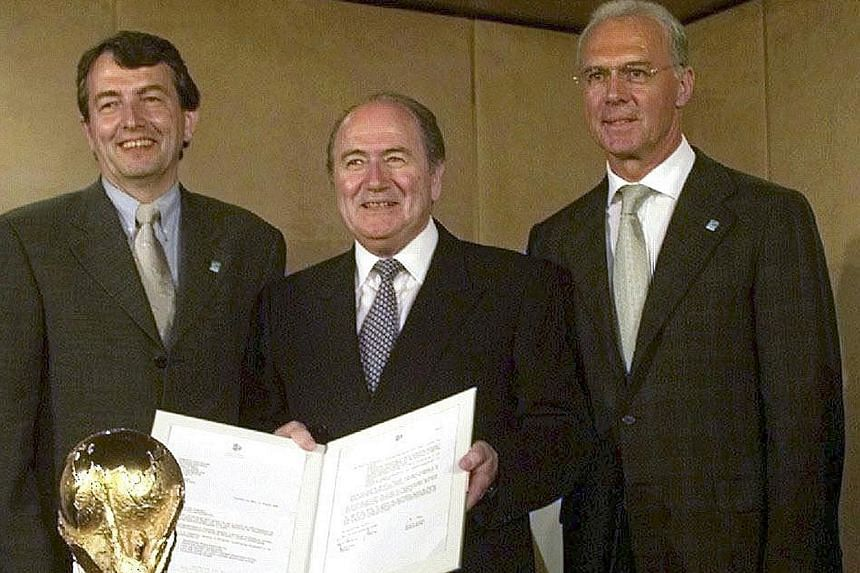 A 1999 file photo of (from left) Wolfgang Niersbach, then a press officer and future head of the German FA, in Zurich with Sepp Blatter and Franz Beckenbauer, head of the bid committee for the 2006 World Cup.