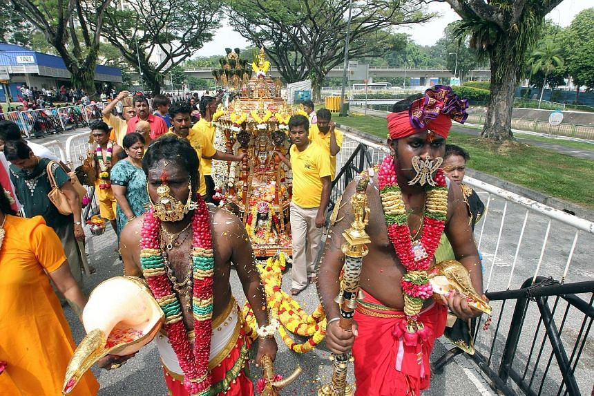 About 8,000 Hindu devotees walked nearly 2km yesterday for the annual Panguni Uthiram festival, held in honour of the Hindu god Murugan. The procession from Canberra Link to the Holy Tree Sri Balasubramaniar Temple in Yishun included 84 bearers of ch