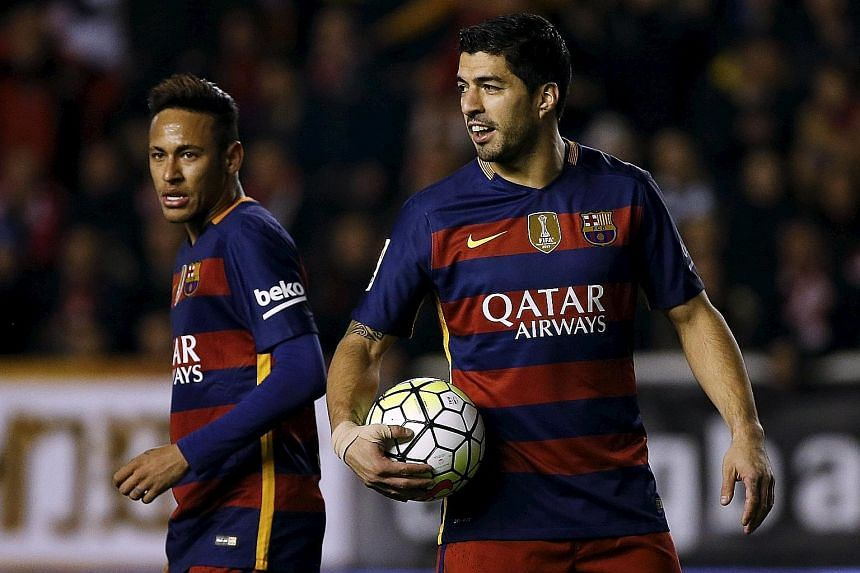 Luis Suarez (right) and fellow Barcelona ace Neymar will be on opposite sides tomorrow in Recife when Uruguay play Brazil in a World Cup qualifier. Suarez is making his comeback to international football after a lengthy ban for violent conduct.