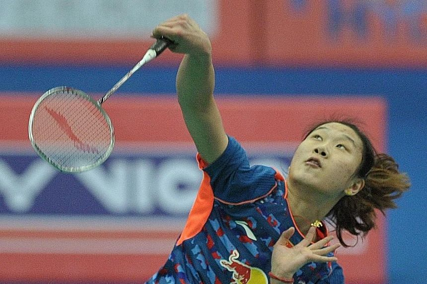 Sun Yu of China (left) leaps for an overhead against Bae Yeon Ju of South Korea at the Badminton Asia Team Championships in Hyderabad, India last month. Sun, the OUE Singapore Open defending champion, will face the Republic's Liang Xiaoyu (above) in