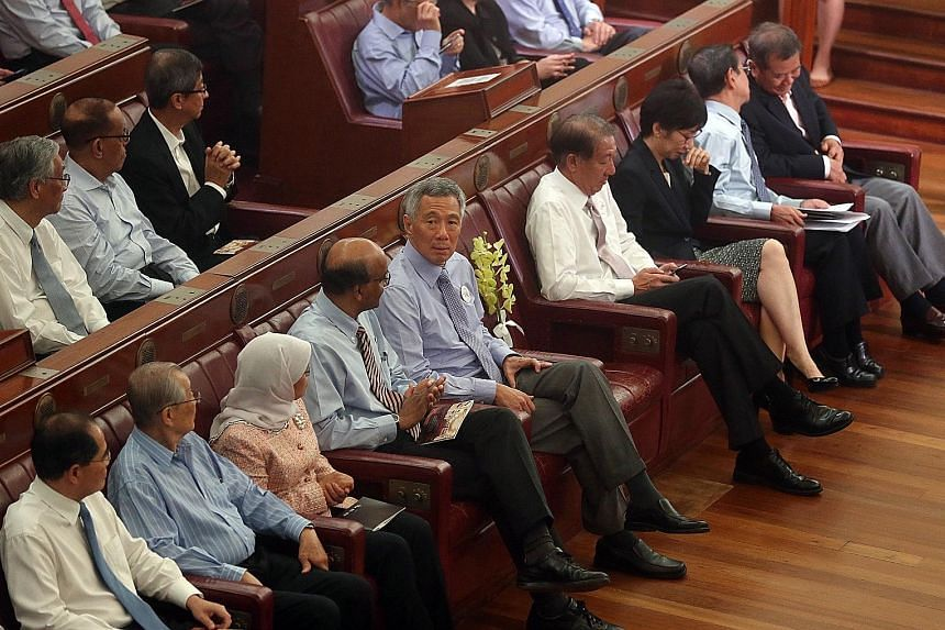PM Lee with past and present parliamentarians at the Chamber of the Old Parliament House, now called The Arts House, yesterday, A spray of yellow hybrid orchids named Aranda Lee Kuan Yew was aptly placed on the seat Mr Lee had occupied - a bitterswee