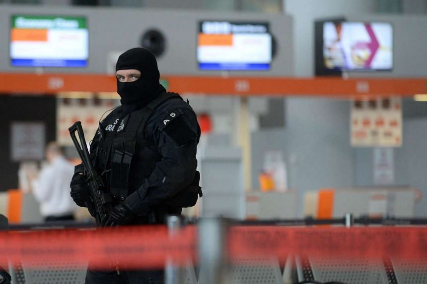 A Polish Border Guard officer at Warsaw Chopin Airport on March 22.