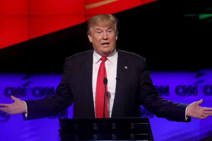 Donald Trump speaks at the Republican US presidential candidates debate in Florida on March 10, 2016.