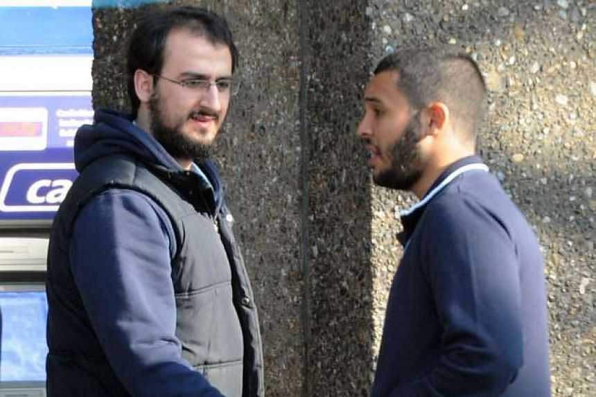 Suhaib Majeed (left) and Tarik Hassane are pictured during a police surveillance operation.