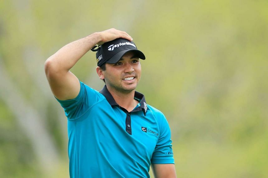 Jason Day of Australia reacts to his tee shot on the third hole during the first round.