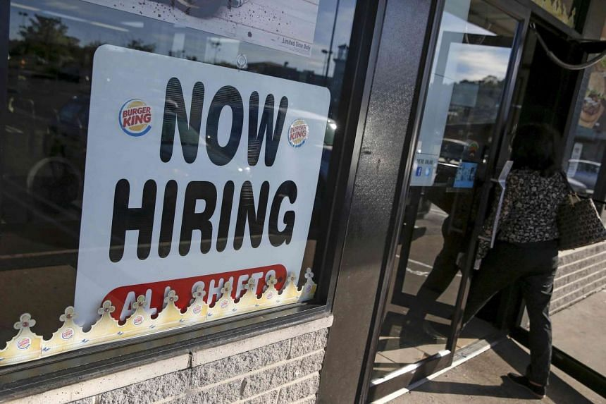 An advertisement for job openings is seen outside a Burger King franchise in Port Washington, New York.
