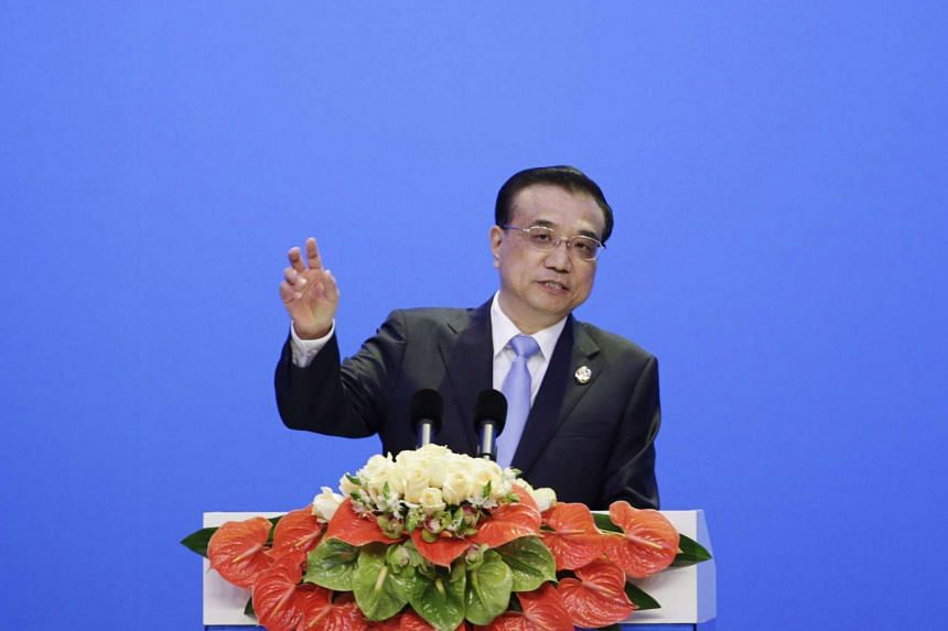 China's premier Li Keqiang speaks during the opening plenary session of the Boao Forum For Asia Annual Conference in Boao, China, on March 24, 2016.