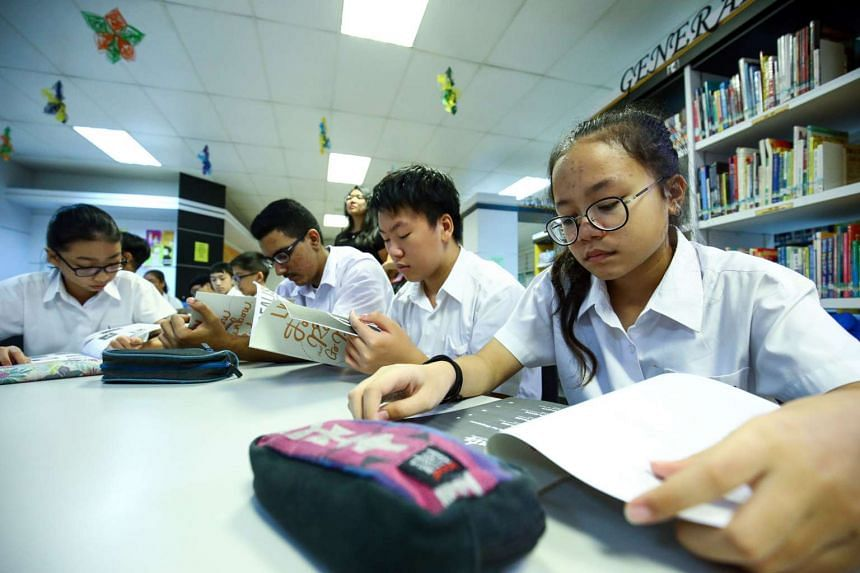 Students taking part in activities during the LKY: Follow the Rainbow, Go Ride it book launch at Bendemeer Secondary School on March 23.