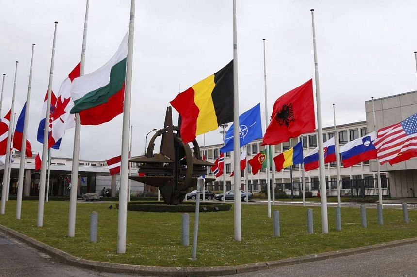Flags fly at half mast at NATO headquarters in Brussels following Tuesday's bomb attacks in Brussels, Belgium on March 23, 2016.