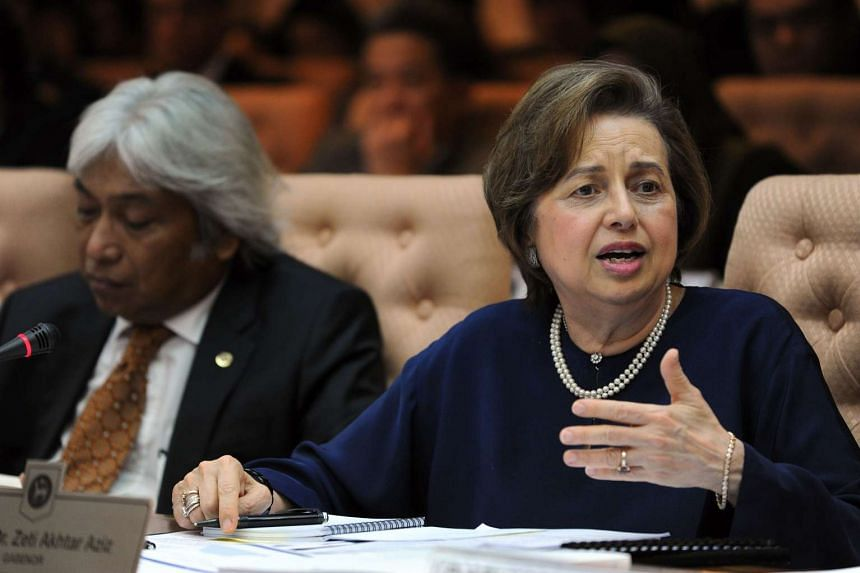 Malaysia's Central Bank Governor Zeti Akhtar Aziz (right) delivers an address at the Bank Negara offices in Kuala Lumpur, on March 23, 2016.