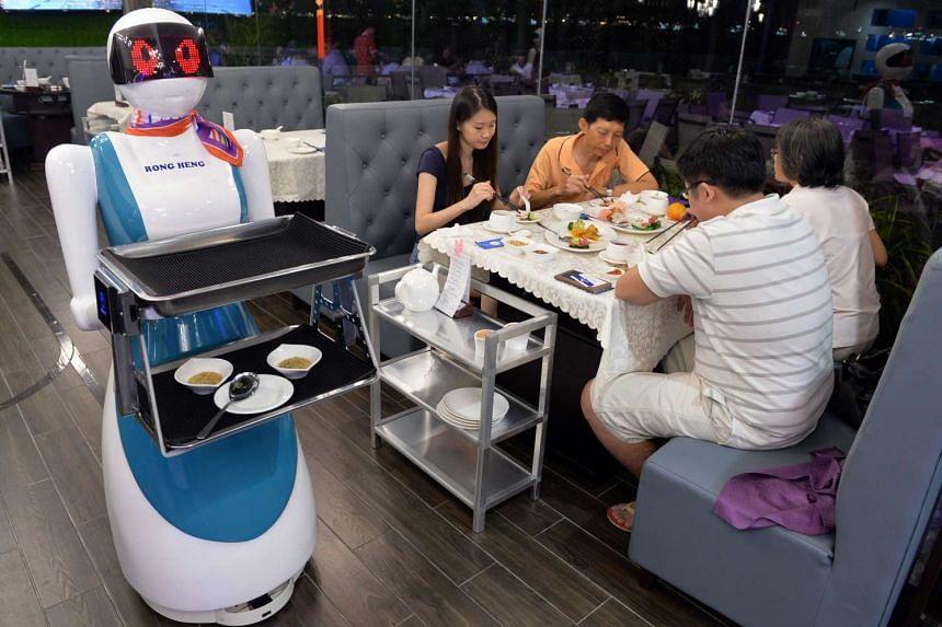 Lucy, a robot waitress, delivers food at Rong Heng Seafood restaurant at East Coast Seafood Centre on Feb 2, 2016.